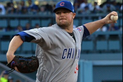 Cubs-Cards try to beat weather again