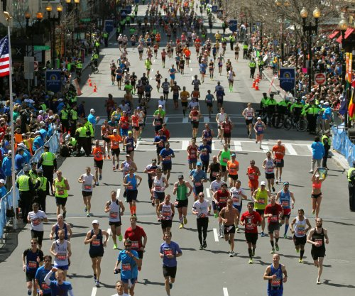 Boston Marathon runner finds man she kissed - thanks to his wife