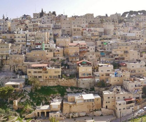 Israel approves building of east Jerusalem homes over objections