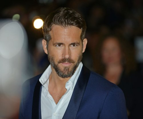 Ryan Reynolds dishes on his physique, costume preferences