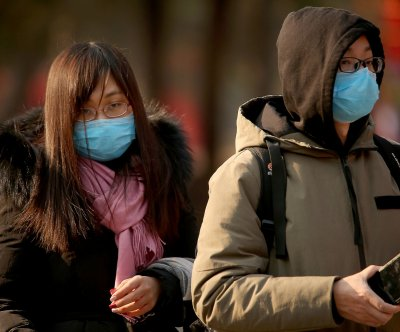 Seoul expands coronavirus checks to all China passengers