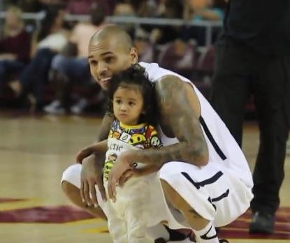 Chris Brown brings daughter Royalty to charity event