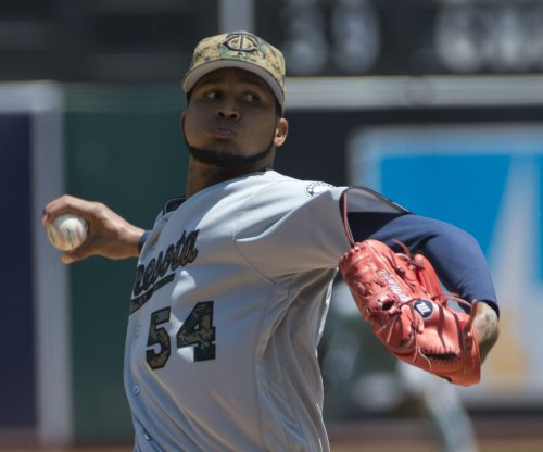 Ervin Santana pitches, hits his way to Minnesota Twins victory over San Francisco Giants