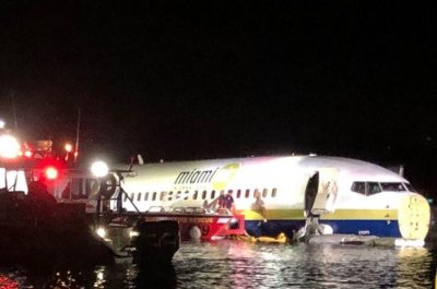 'A miracle': Minor injuries after jet slides off runway into river
