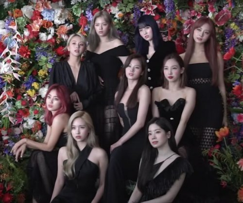 Twice members pose in 'Eyes Wide Open' jacket making film