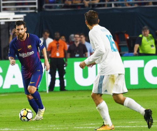 Lionel Messi: Barcelona star signs contract until 2021 with $850M buyout