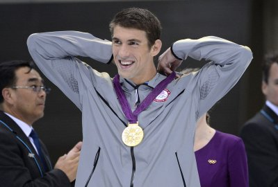 Olympic Roundup: Phelps, newcomers shine