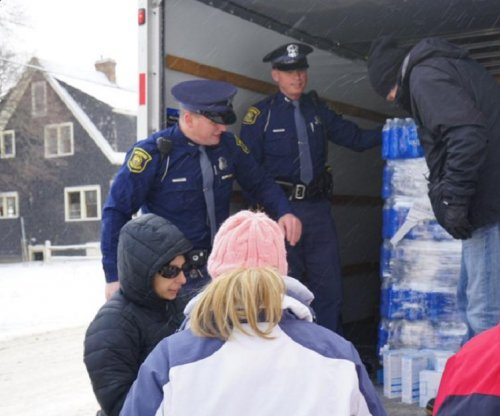Michigan governor calls up National Guard to help with Flint lead water crisis