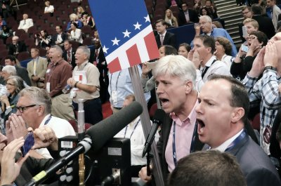 Republican National Convention opens with floor fight over party rules