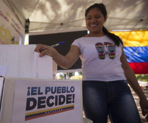 Venezuelan opposition holds poll to determine Maduro's support