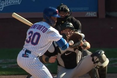 Umpire admits to wrong, game-ending call in Marlins-Mets game