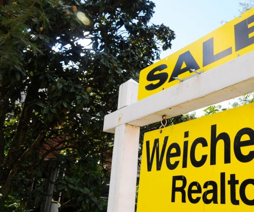 Sales of existing homes slid 6 percent in November