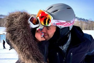 Nina Dobrev, Austin Stowell cozy up in snowy photo