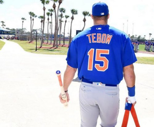 Tim Tebow collects first hit of spring