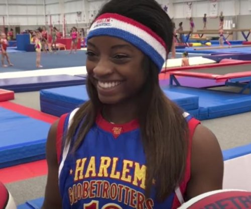 Simone Biles learns how to be a Harlem Globetrotter