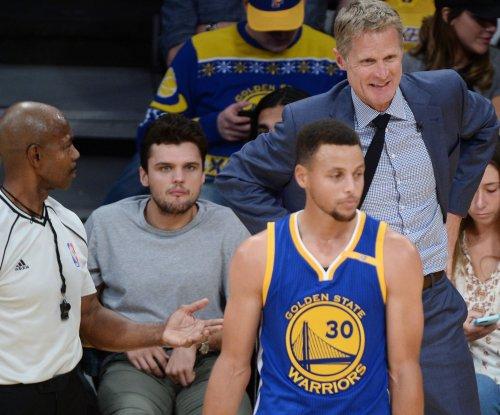 Warriors visit Mavericks on rare losing streak
