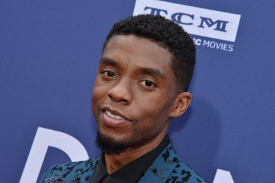 Chadwick Boseman revels in grit of '21 Bridges' cop drama