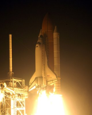 Space station crew welcomes shuttle crew