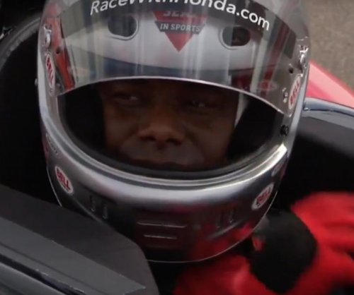 Watch: Ken Griffey Jr. races IndyCar with Mario Andretti