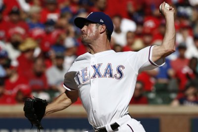 Texas Rangers' Hamels throws four-hitter, defeats Minnesota Twins