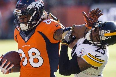 Broncos pick up option on WR Thomas