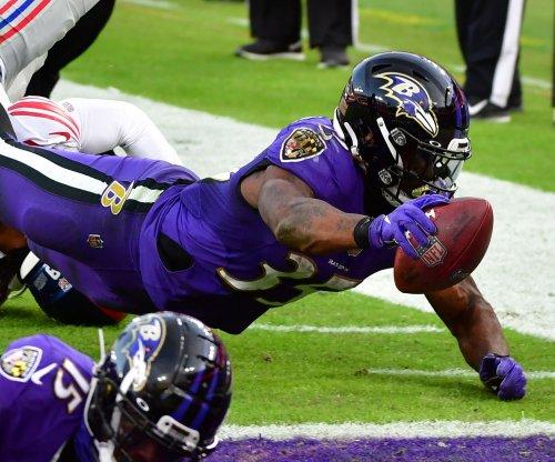 Baltimore Ravens extend RB Gus Edwards, to sign OT Ja'Wuan James