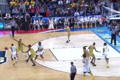 NCAA: West Virginia ousts Notre Dame behind Jevon Carter's 24