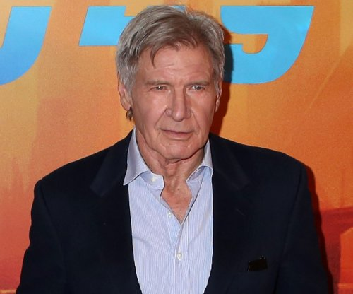 Harrison Ford helps woman whose car drove off the road