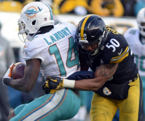 Dolphins' Landry signs franchise tender, opens door for trade