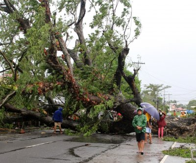 Typhoon Kammuri weakens after killing 17 in Philippines