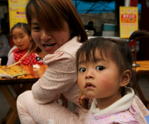 China considers incentives for couples to have second child