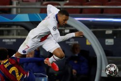 Champions League soccer: Mbappe hat-trick leads PSG over Barcelona