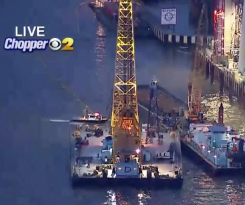 Crane to raise sunken Hudson River tugboat, recover body of third crewmember