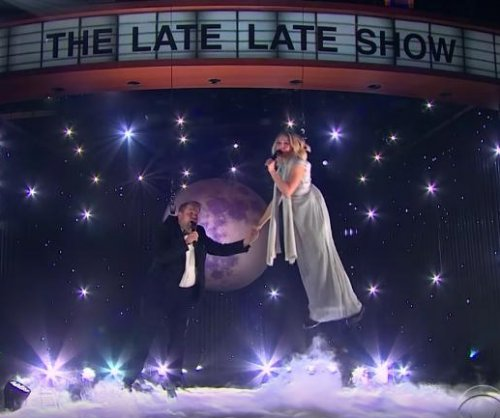 Kristen Bell, James Corden struggle to perform aerial duet
