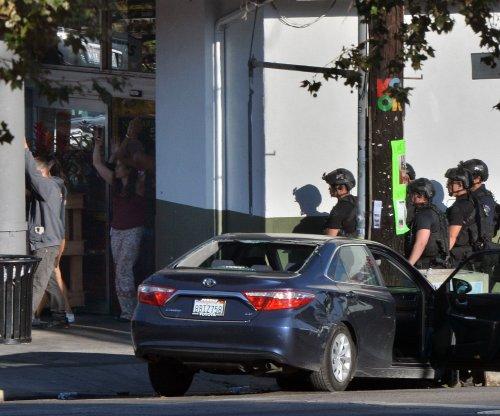 Woman dies, gunman surrenders after L.A. Trader Joe's standoff