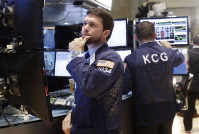 Stocks mixed as smoke clears from D.C. deal making