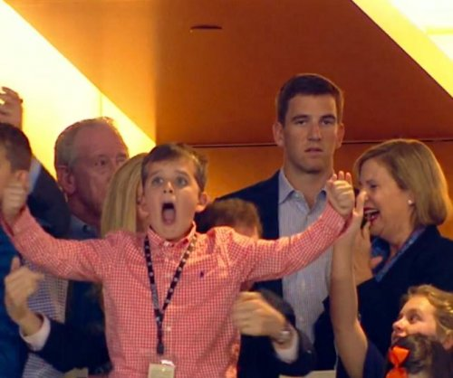Eli Manning explains pout after Denver Broncos' Super Bowl score