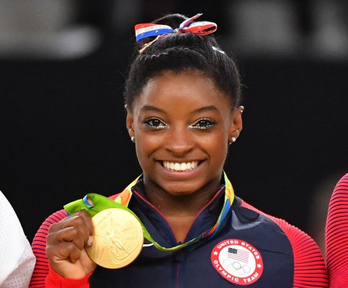 Simone Biles all smiles after snatching gold in floor