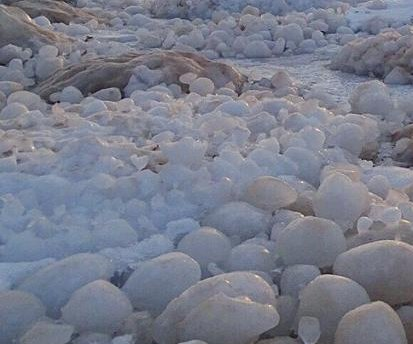 'Gazillions' of natural ice balls cover Lake Michigan beach