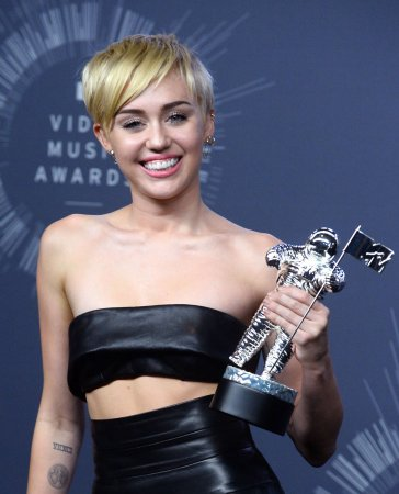 Miley Cyrus says she is a 'walking joke'