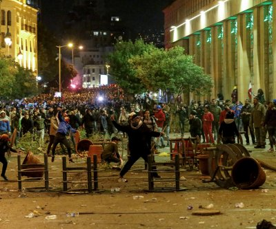 Dozens injured as police, protesters clash in Beirut