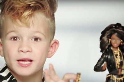 First boy ever in Barbie ad spurs sales of Moschino doll