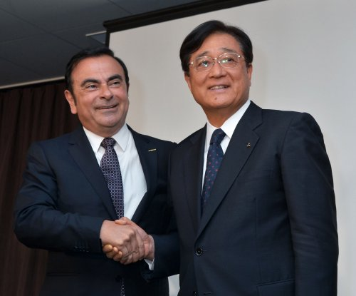 Nissan buys 34 percent of beleaguered Mitsubishi