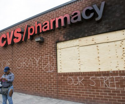 Baltimore police arrest suspected arsonist of pharmacy during Gray riots