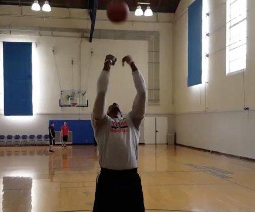 Houston Rockets' Dwight Howard sinks deep trick shot