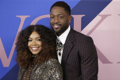 Dwyane Wade holds daughter in new photos: 'Daddy's girl'