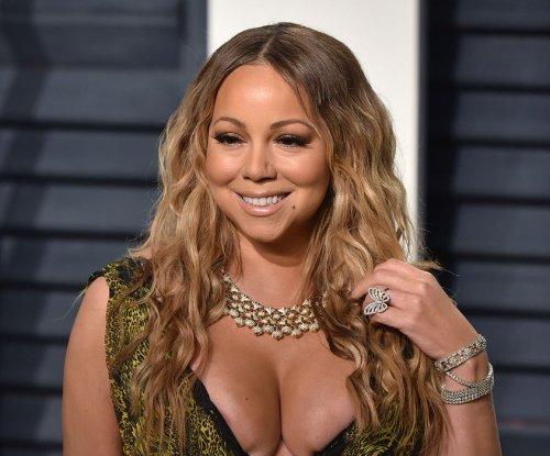 Mariah Carey, Bryan Tanaka hold hands after split