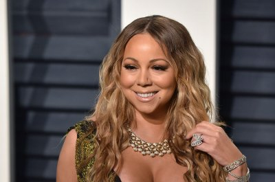 Mariah Carey, Bryan Tanaka hold hands after split
