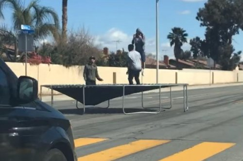 California men hold up traffic with mid-road trampoline session