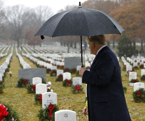 Trump observes wreath-laying at Arlington National Cemetery